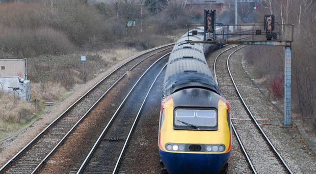 A walker was rescued by a train after becoming injured in inaccessible woodland in the Midlands