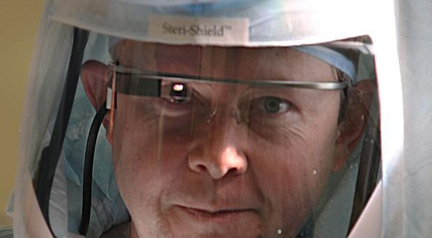 Surgeon David Issac wearing Google Glass during an operation (South Devon Healthcare NHS Foundation Trust /PA)