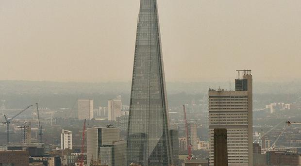 The Shangri-La Hotel at The Shard sits on the upper floors of the 306m-tall skyscraper in central London