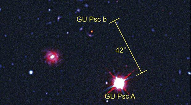 The planet GU Psc b and its star GU Psc (A) consisting of visible and infrared telescope images, as infrared light is invisible to the naked eye, astronomers represent it using the colour red (University of Montreal/Gemini Observatory/PA)