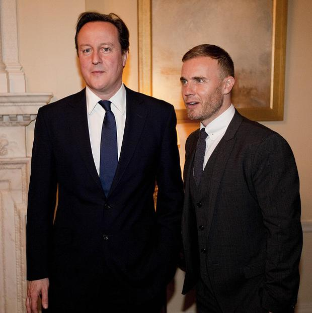 David Cameron has previously said it was not 'necessary' to remove Gary Barlow's OBE