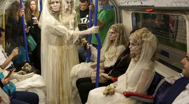 A group of Miss Havishams rode the tube, ahead of a special screening of Great Expectations on UKTV Drama channel