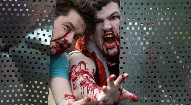 People dressed as zombies will take to the streets of Edinburgh and Glasgow for 2.8 Hours Later, a cross-city urban chase game