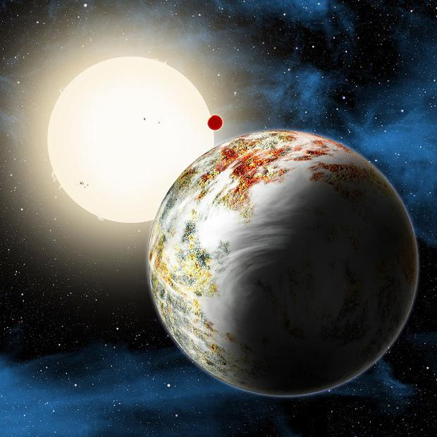 An artist's impression of 'mega-Earth' Kepler-10c which dominates the foreground. Its sibling, the lava world Kepler-10b, is in the background. (Harvard-Smithsonian Center for Astrophysics/PA)