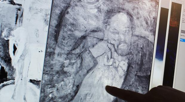 An image of a mystery man has been found underneath one of Picasso's first masterpieces, The Blue Room (AP)