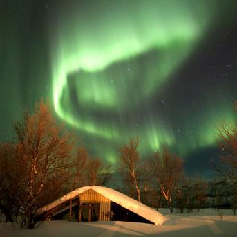 Seeing the Northern Lights takes the top slot on Britons' bucket lists, a survey shows