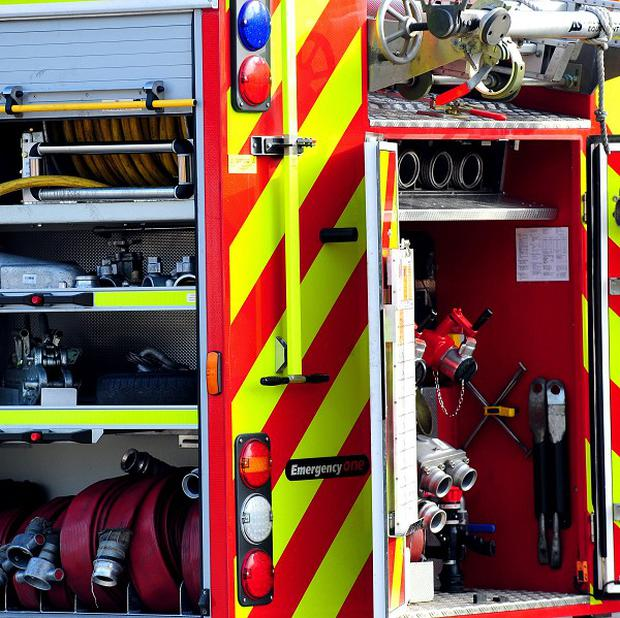 A 15-year-old girl who became stuck in a dog-flap after being locked out of her home has been rescued by firefighters