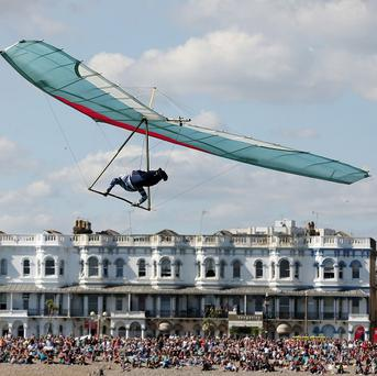 Ron Freeman glides from Worthing Pier in West Sussex