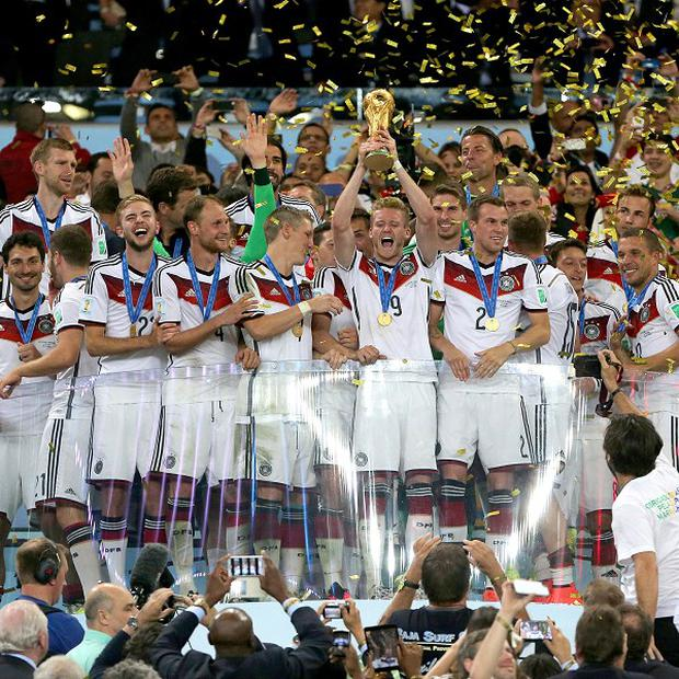 Germany celebrate with the World Cup trophy