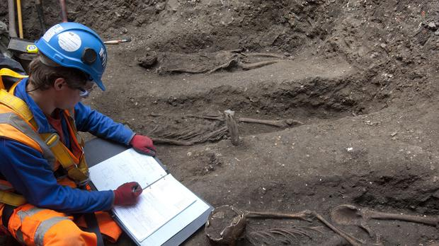 Archaeologists work in the plague burial ground in Farringdon, London, that were uncovered during building work for the Crossrail project (Crossrail)