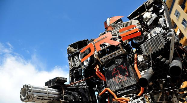 A towering Transformer figure, mostly made of old car parts and other waste is seen in Podgorica, Montenegro (AP)