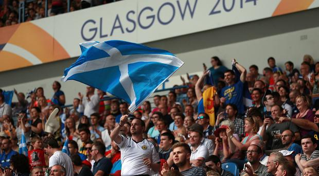 Scotland fans in the crowd show their support during the Rugby 7's at Ibrox Stadium