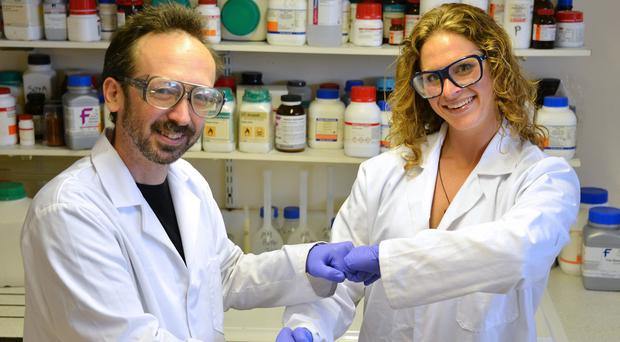 Dr Dave Whitworth and Sara Mela demonstrate the fist bump (Anthony Pugh Photography/Aberystwyth University)