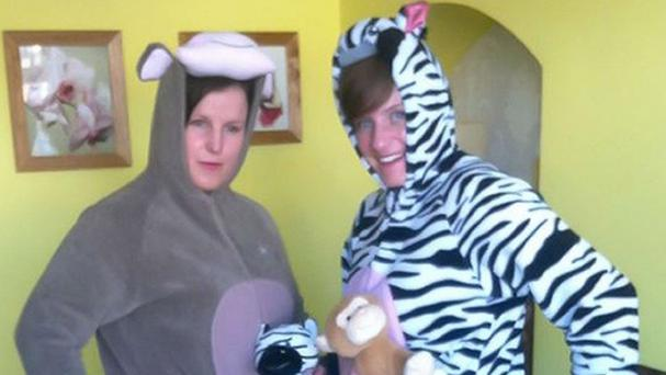 Pcs Tracy Griffin and Terri Cave dressed in zebra and monkey onesies and later had to arrest a man (West Midlands Polic/PA)