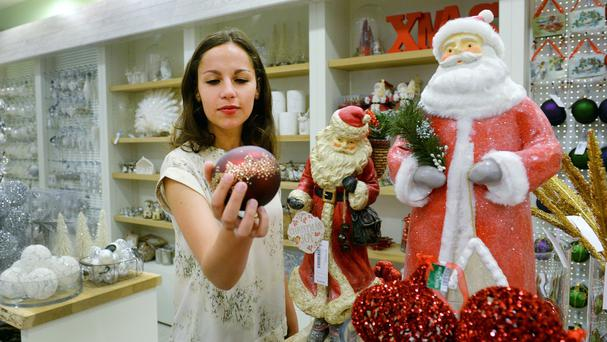 Staff at Selfridges in London look at this year's Christmas shop