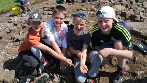 Undated handout photo issued by North Pennines AONB Partnership of four schoolboys (from left) Aidan Bell, ten, Luca Alderson, eight, Joseph Bell, seven and Sebastian Alderson, ten who found a 4,000-year-old intricately decorated golden hair tress that dates back to around 2,300 BC whilst taking part in a dig at Kirkhaugh, Northumberland. PRESS ASSOCIATION Photo. Issue date: Monday August 4, 2014. See PA story HISTORY Gold. Photo credit should read: North Pennines AONB Partnership/PA WireNOTE TO EDITORS: This handout photo may only be used in for editorial reporting purposes for the contemporaneous illustration of events, things or the people in the image or facts mentioned in the caption. Reuse of the picture may require further permission from the copyright holder.