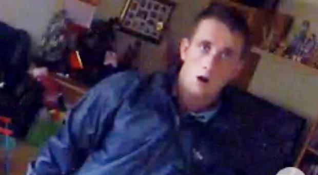A burglar is surprised to be caught on camera as he raids a home in Daventry. (Northamptonshire Police/PA)
