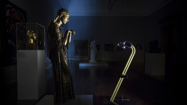 An After Dark project robot with Jacob Epstein's The Visitation (1926). (Alexey Moskvin/Tate Britain/PA)