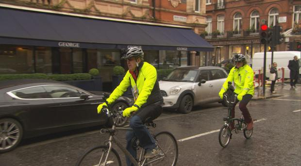 James May, right, and Jeremy Clarkson on bikes in central London