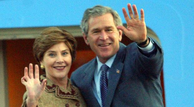 Laura Bush doused her husband and former president George W Bush with ice water for charity
