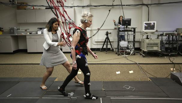 University physical therapy assistant professor Tanvi Bhatt, left, walks alongside Mary Kaye, 81 during a treadmill balance session (AP)