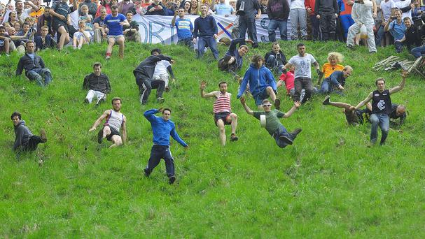 Competitors in the Cheese Rolling on Cooper's Hill race near Brockworth, Gloucestershire.