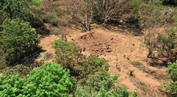 The impact crater made by a small meteorite in a wooded area near Managua's international airport (Nicaraguan Army/AP)