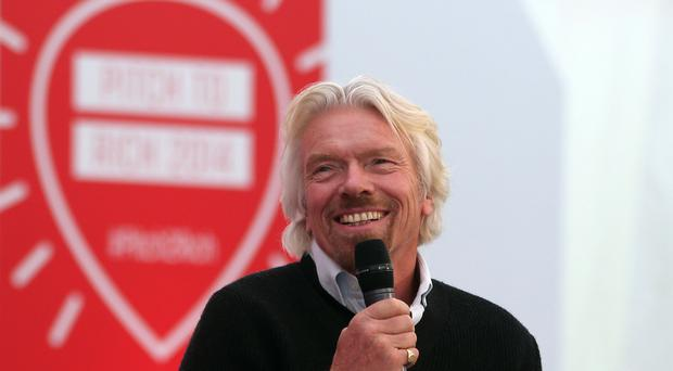 Sir Richard Branson is urging Virgin workers to take time off so long as it does not affect the business