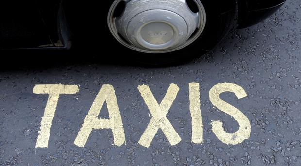 Public hire taxi drivers in Belfast fear they are being victimised after traffic wardens were instructed to clamp down on unattended vehicles in taxi ranks