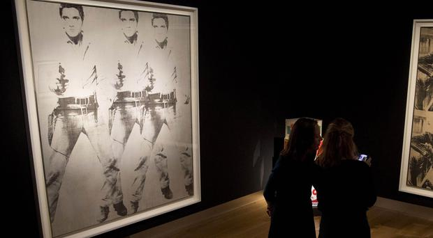 Andy Warhol's Triple Elvis portrait at the offices of Christie's auction house. (AP)