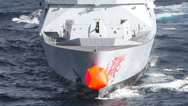 HMS Dragon in the Atlantic off the west coast of Africa with a red nose attached to it to support Red Nose Day (Ministry of Defence/PA)