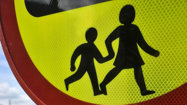 A fire engine on its way to a 999 call was stopped by a lollipop man so children could cross the road