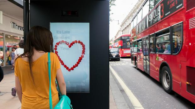 An advertising billboard on Oxford Street in London that uses artificial intelligence to react to the emotions of viewers (M&C Saatchi/PA)