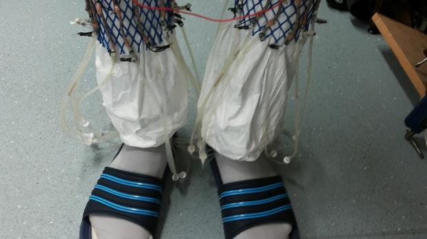 A pair of socks fuelled with urine pumped by the wearer's footsteps which has powered a wireless transmitter to send a signal to a computer. Photo by: University of the West of England /PA