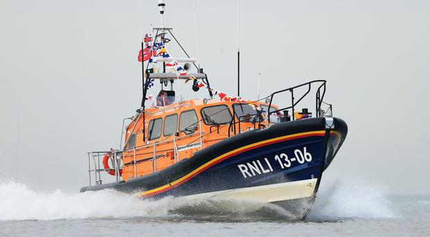 Portaferry RNLI was scrambled at 12.40pm yesterday after walkers spotted the men on Boretree Island using flags to signal for help