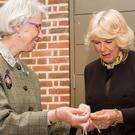 The Duchess of Cornwall meets craftswoman Elizabeth Lee during a visit to the Geffrye Museum in east London (Royal Voluntary Service/PA Wire)
