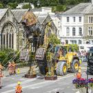 The largest mechanical puppet ever built in Britain, Cornish Man Mining Engine, is unveiled in Tavistock to hundreds of people