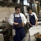 Chefs work at the gourmet soup kitchen Refettorio Gastromotiva in Rio de Janeiro, Brazil (AP)