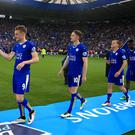 Leicester City's Jamie Vardy and his team-mates walk up to collect their winners' medals last season