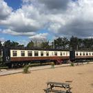 Chalets in a converted rail carriage at a holiday park in Devon which is set to go under the hammer next month.