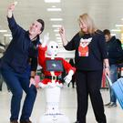 GLAdys, the UK's first humanoid robot airport ambassador, meets passengers at Glasgow Airport (PA/Nick Ponty)