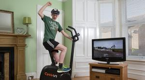 Aaron Puzey on his exercise bike at home in Monifieth, near Dundee (Robert PerryImage/PA Wire)