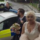 Bride and groom Georgia and Emmott Garnett thanked police (Lancashire Police/PA)