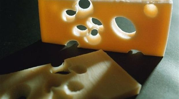 Cheese prices in Northern Ireland could soar by almost 60% after Brexit and milk by nearly a third, an agri-food industry event has been told. (AP)