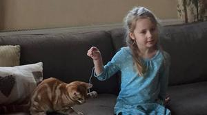 Eliza Adamson-Hopper, five, playing with her cat Mittens