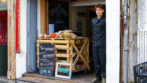 Sam Joseph, co-director of Skipchen, outside the new cafe that serves meals made from food rescued from the bin it has opened in Bristol (The Real Junk Food Project of Bristol Skipchen/PA)