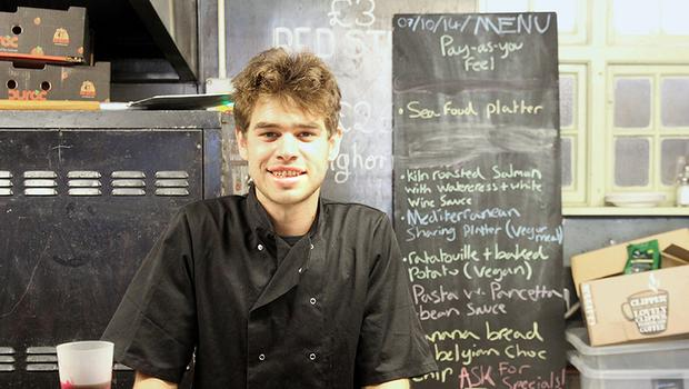 Sam Joseph, co-director of Skipchen, inside the new cafe that serves meals made from food rescued from the bin it has opened in Bristol (The Real Junk Food Project of Bristol Skipchen/PA)