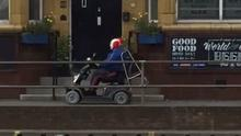 A clown on a mobility scooter heads south on Penistone Road in the Hillsborough area of Sheffield (Martin Lee Car Sales/PA)