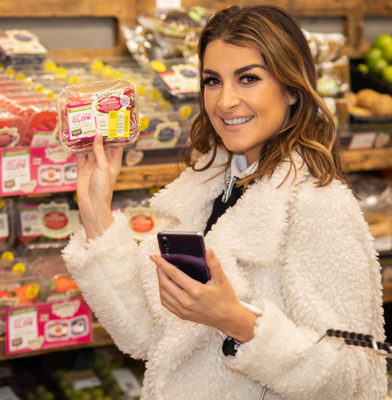 Blogger Denise Curran using the Gander app in store