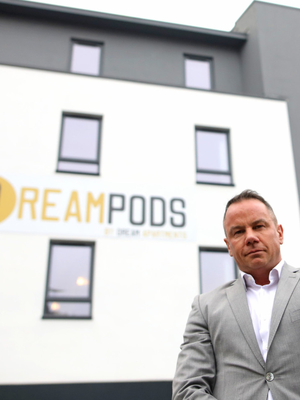 Dream Apartments chief Tom Smyth outside the premises in Belfast city centre